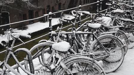 Bikes along the canals in Utrecht in a winter snow storm, Netherlands.