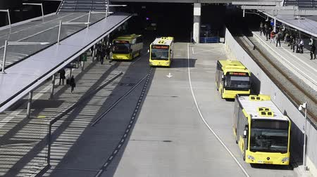 london cab : Utrecht, The Netherlands - March 23, 2017: Bus station with yellow buses and travelers near central railway station of Utrecht, The Netherlands. Stock Footage