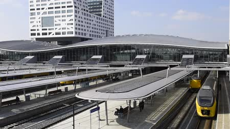 Utrecht, The Netherlands - March 23, 2017: Railway station Utrecht Central or the NS with glass roofs, platforms and office buildings (Stadskantoor).