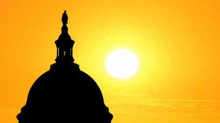 united states : US Capitol dome silhouette with time lapse sunset.