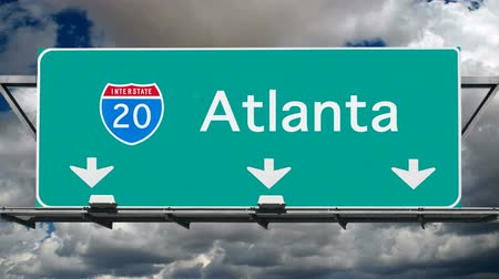 yirmi : Atlanta Interstate 20 overhead freeway sign with time lapse clouds.