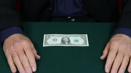 маг : Master magician changes one dollar bill to one hundred.