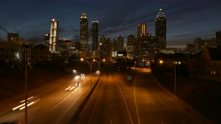 ga : Downtown Atlanta skyline and time lapse highway traffic at dusk. Stock Footage