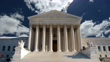 United States Supreme Court building with churning clouds in Washington DC. Stock Footage