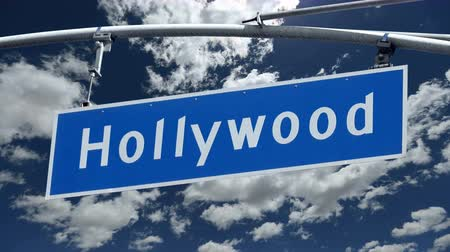 бульвар : Hollywood Bl Street Sign with Time Lapse Clouds
