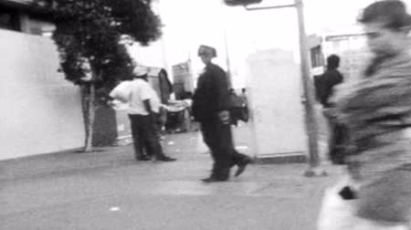 homeless : Vintage 1988 editorial super 8 driving shot of skid row in downtown Los Angeles.