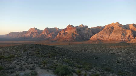 rocks red : Dawn light time lapse on desert mountain cliffs at Red Rock Canyon National Conservation Area near Las Vegas, Nevada.