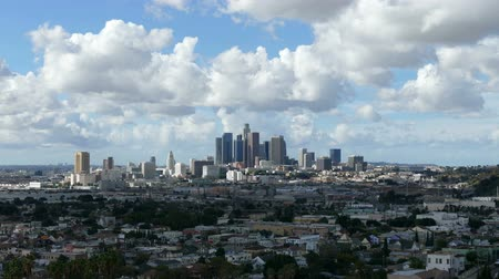 небоскреб : Downtown Los Angeles cityscape time lapse with clearing after storm skies.