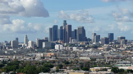 határkő : Downtown Los Angeles cityscape telephoto time lapse with clearing after storm skies.