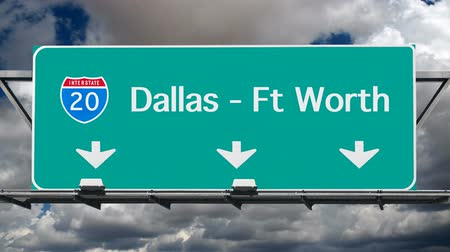 resmedilmeye değer : Dallas, Ft Worth Interstate 20 freeway sign with time lapse sky. Stok Video