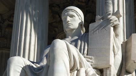 spravedlnost : Authority of Law statue with zoom at the United States Supreme Court building.