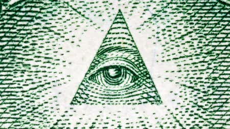 pyramida : Macro zoom on the eye of providence on the back of the US one dollar bill.