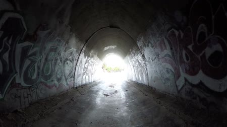 распад : Simi Valley, California, USA - April 11, 2015:  Graffiti covered tunnel under the ten lane 118 freeway near Los Angeles in Southern California. Стоковые видеозаписи
