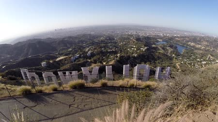 határkő : Los Angeles California USA  April 16 2015:  Moving view behind the famous Hollywood sign in Los Angeless Griffith Park.