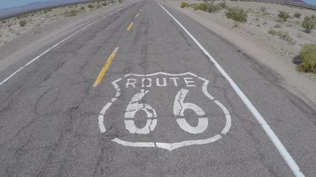 droga : Route 66 pavement sign in Californias Mojave desert.