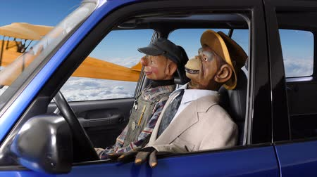 долл : Vintage puppets in flying car passing biplane.