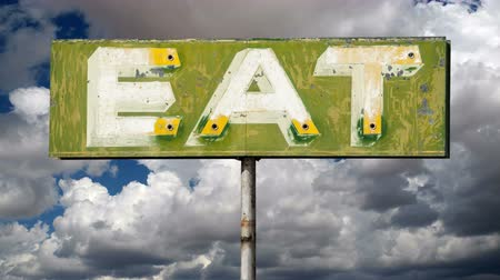 étkező : Vintage eat sign with moving clouds time lapse.