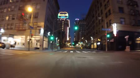 bina : Los Angeles, California, USA - July 26, 2015:  Downtown night driving on 5th street in Los Angeless urban core.