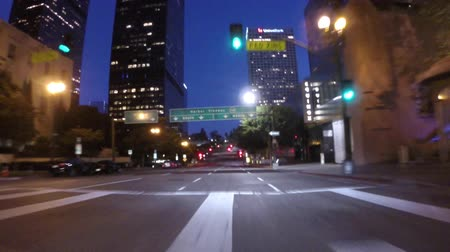 в центре города : Los Angeles, California, USA - July 26, 2015:  Downtown night driving time lapse with 30 green lights in a row.