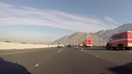 fire officer : Simi Valley, California, USA - August 14, 2015:  Fire crews, emergency vehicles and brush fire lane closures on the 118 freeway near Los Angeles.