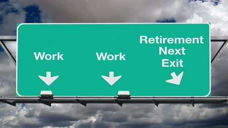 retirement : Work or retirement overhead freeway sign with time lapse storm clouds.