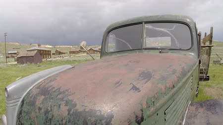 abandoned old : Bodie, California, USA - July 6, 2015:  Old abandoned truck inside Bodie Ghost Town in Californias Sierra Nevada Mountains. Stock Footage