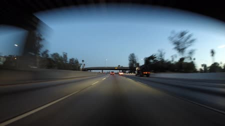 prędkość : Los Angeles, California, USA - August 2, 2015:  Dawn driving time lapse of downtown Los Angeles streets and freeways.