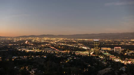 универсальный : Los Angeles, California, USA - November 18, 2015:  San Fernando Valley day to night time lapse view from famous Mulholland Drive.