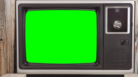 stary : Vintage television with zoom into chroma green screens.
