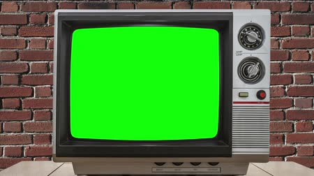régi : Vintage Television Zooming into Static and Chroma Green Screens Stock mozgókép