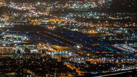 uluslararası : Night Airport Cityscape Time Lapse with Zoom in Burbank and Los Angeles California Stok Video