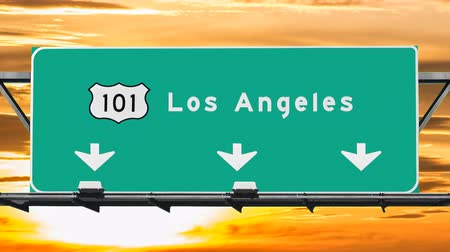 havai : Los Angeles 101 freeway sign with sunrise sky time lapse.
