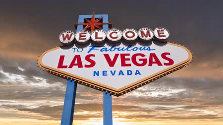 jel : Welcome to fabulous Las Vegas sign with colorful sunset sky time lapse.