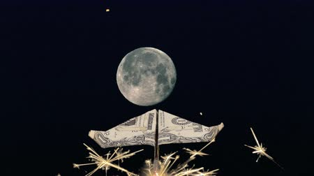 roket : Dollar paper airplane flying with sparkler rockets flying towards full moon.
