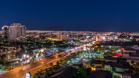 gün : Las Vegas, Nevada, USA -  May 9, 2016:  Las Vegas day to night time lapse with zoom out of Flamingo Road east of the strip.