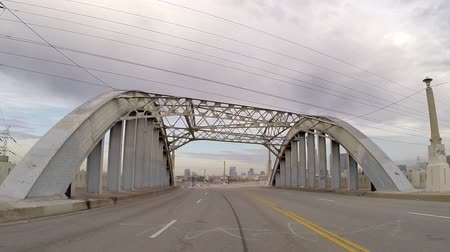lebontották : Los Angeles, California, USA - June 28, 2015:  Driving rear view car mount time lapse of the historic 6th street bridge in downtown Los Angeles.