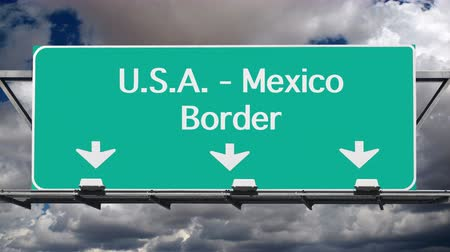 meksyk : USA Mexico border crossing highway sign with time lapse clouds. Wideo