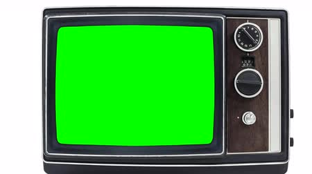 tv screen : Small vintage television on white with zoom into chroma green screen.
