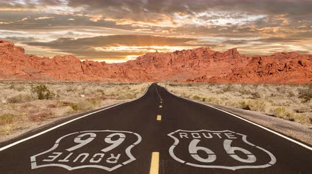 rota : Route 66 Mojave desert highway sign with romanticized sunrise time lapse.