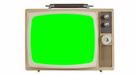 tüpler : Vintage 1970s television on white with zoom into chroma green screen. Stok Video