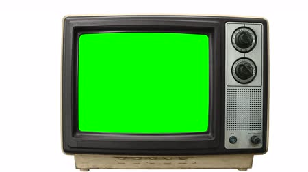 tüp : Dirty Grungy vintage television on white with zoom into chroma green screen.
