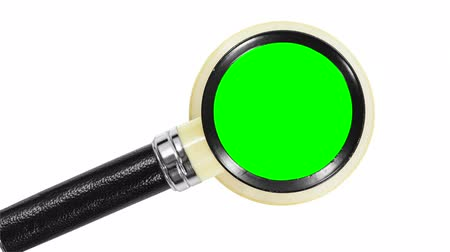 используемый : Vintage magnifying glass with zoom into chroma key green insert. Стоковые видеозаписи