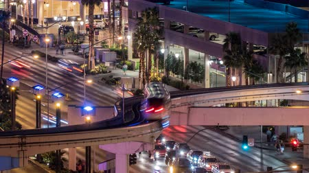usa : Las Vegas, Nevada, USA - February 25, 2016:  Las Vegas Flamingo Road monorail overpass night traffic time lapse.