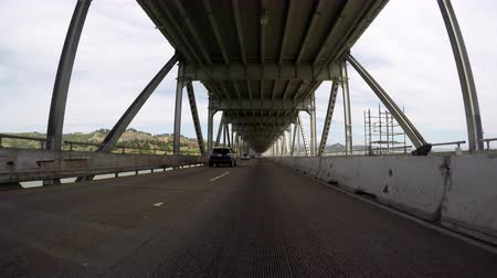 richmond : Richmond, California, USA - April 24, 2016:  Richmond bridge lower deck driving time lapse over San Francisco bay.