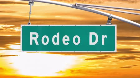 drive : Rodeo Drive Beverly Hills Sign with Sunset Time Lapse Sky Stock Footage