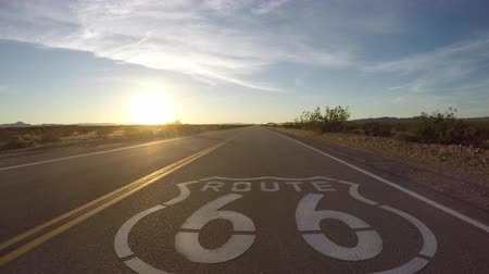 rota : Route 66 pavement sign sunset driving shot in the California Mojave Desert.