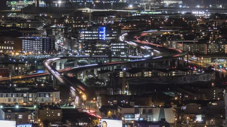 janeiro : San Francisco, California, USA - January 14, 2017:  Night traffic time lapse with zoom out of highway 280 in the Mission Bay district south of downtown.