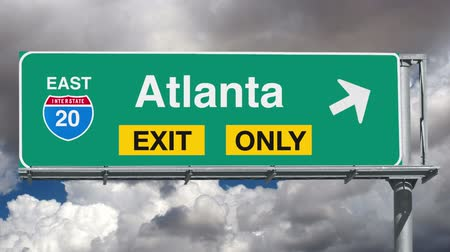 ga : Atlanta Interstate 20 exit sign with time lapse clouds and zoom.