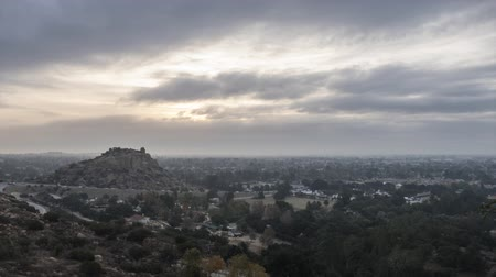 пригородный : Morning clouds time lapse with zoom out of Stoney Point in the San Fernando Valley area of Los Angeles, California. Стоковые видеозаписи