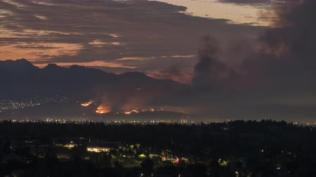 bush fire : Dawn time lapse of La Tuna wildfire burning on Verdugo Mountain near Burbank and Los Angeles, California.
